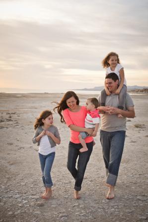 family-walking-along-beach-1117003-gallery